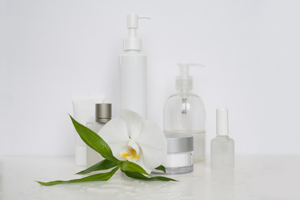 White cosmetic bottles on a white background